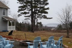 20 Acre Woods Bed And Breakfast - Backyard Sitting Bonfire Area, View of Ingonish Bay / Mountains